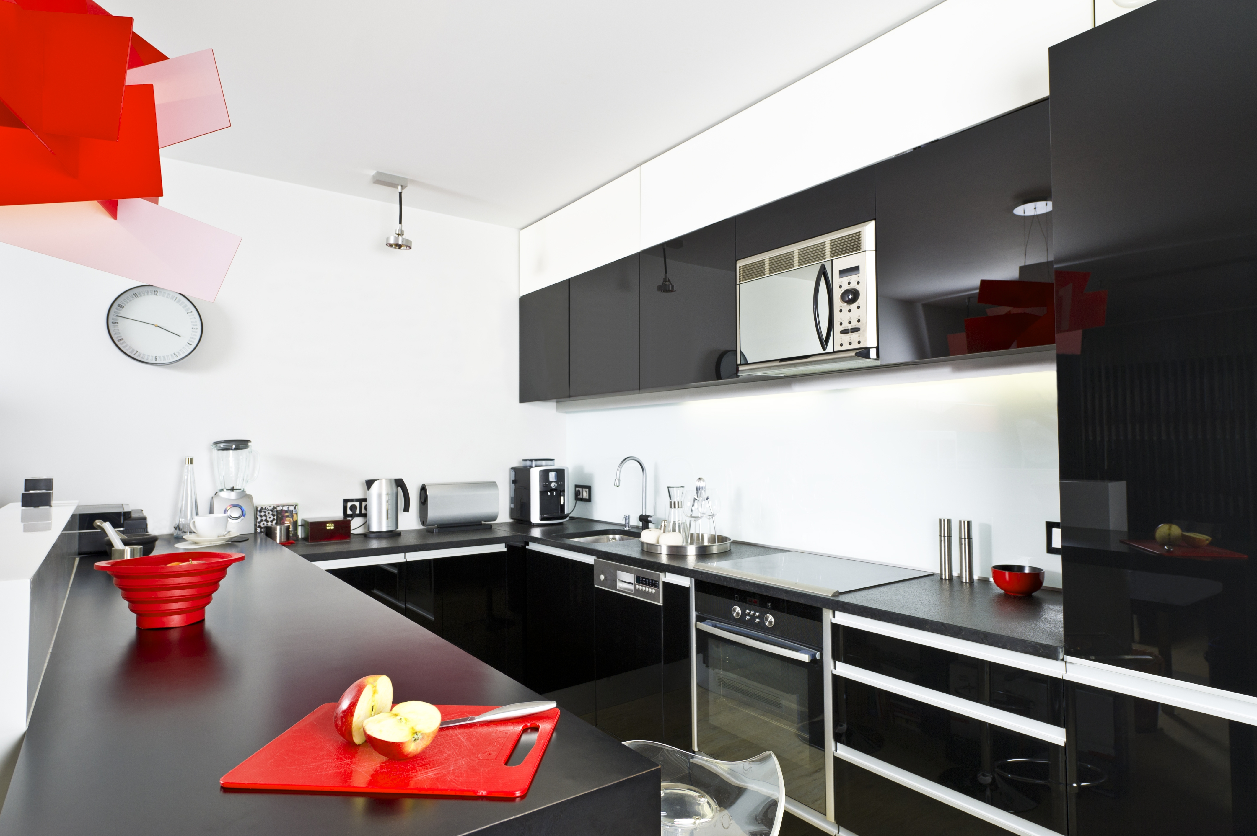Black And White Kitchen Decorated With Red