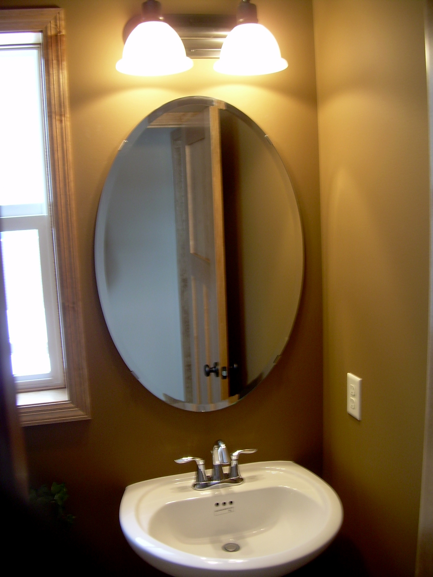Brown Oval Bathroom Mirrorbathroom mirrors for bathrooms ideas hung on cream wall with oval