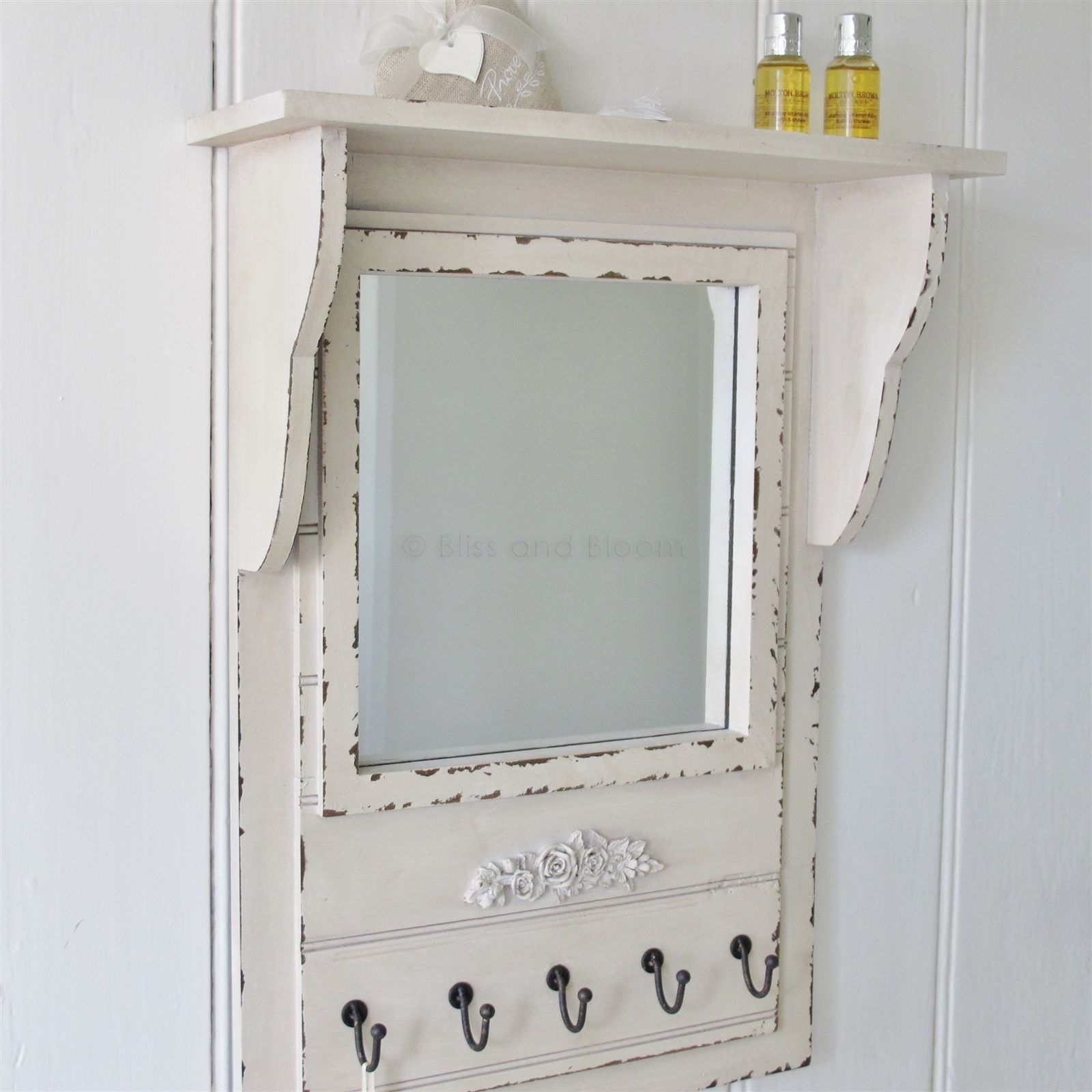 Mirrored Wall Shelf With Hooks