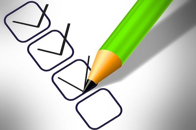 A checklist with a green pencil