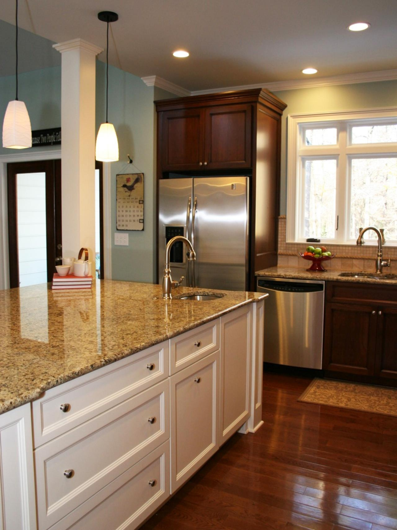 Brown Kitchen Cabinets With White Island