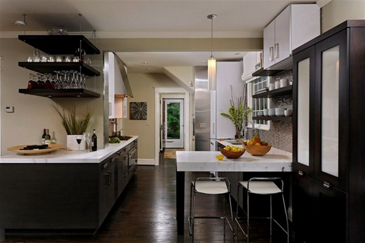 Kitchen With Dark Floors And White Cabinets