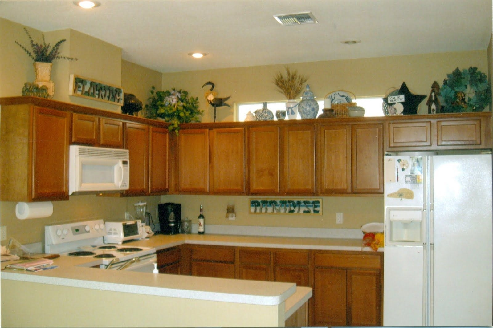 Decor For Space Above Kitchen Cabinets