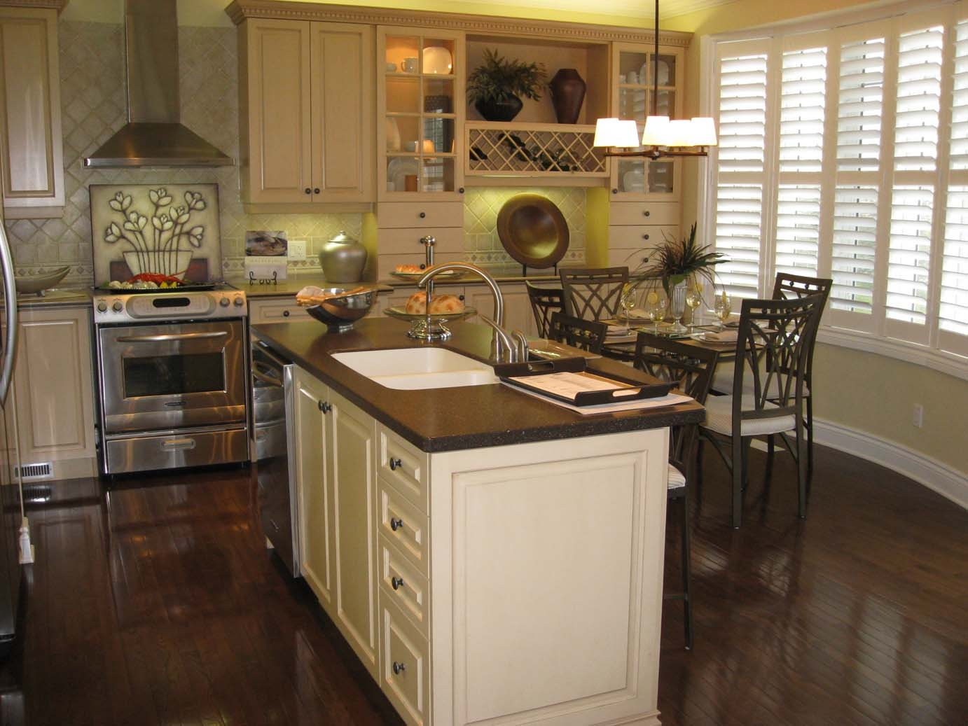 Ivory Kitchen Cabinets With Dark Wood Floors
