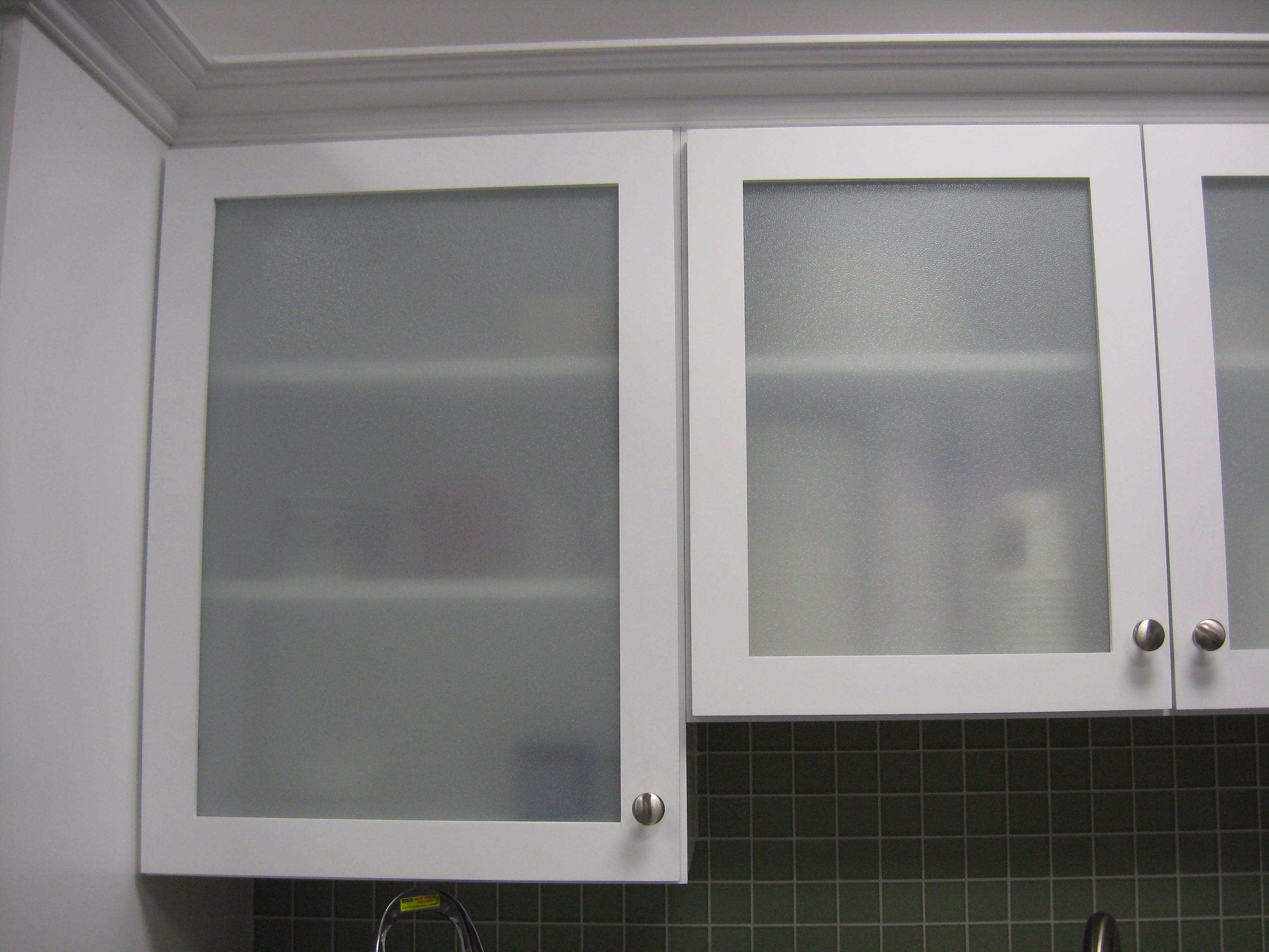 Kitchen Cabinets With Sliding Glass Doors