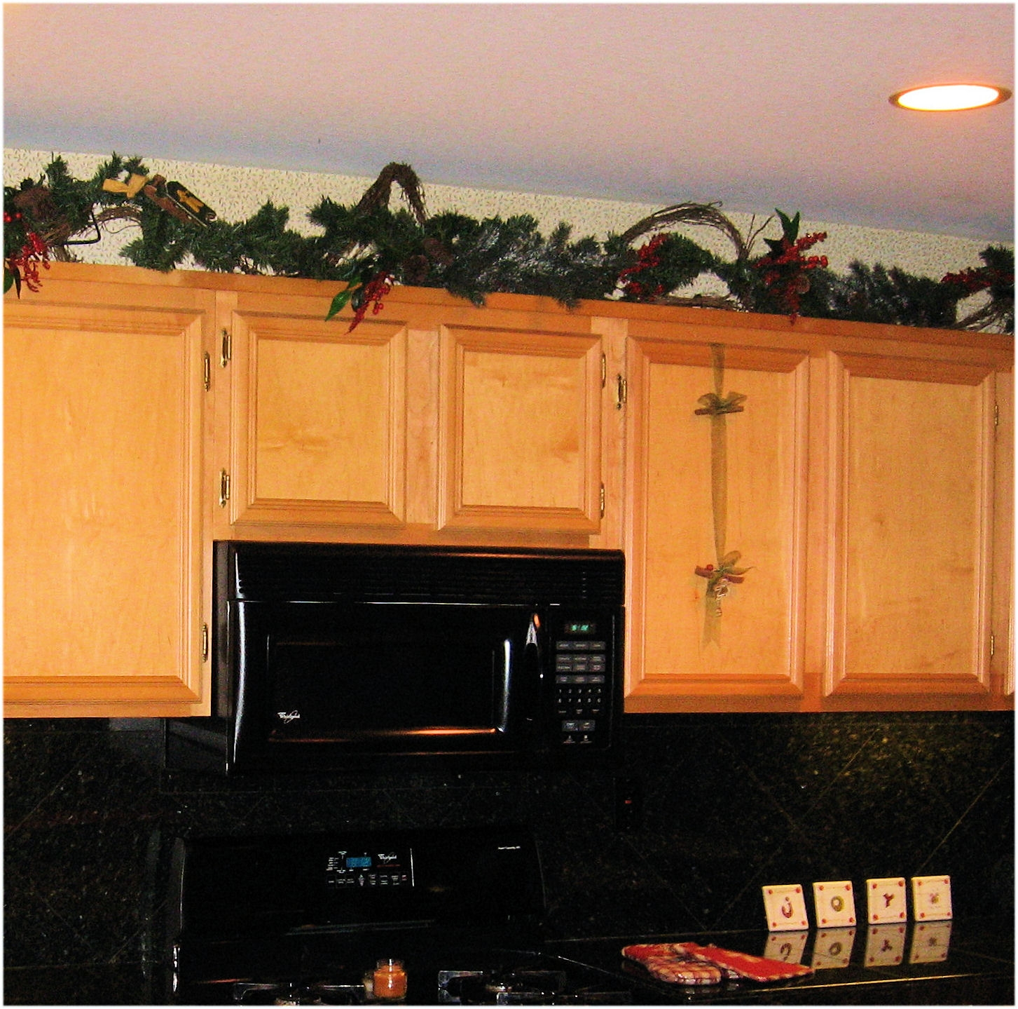Lighted Garland Above Kitchen Cabinets