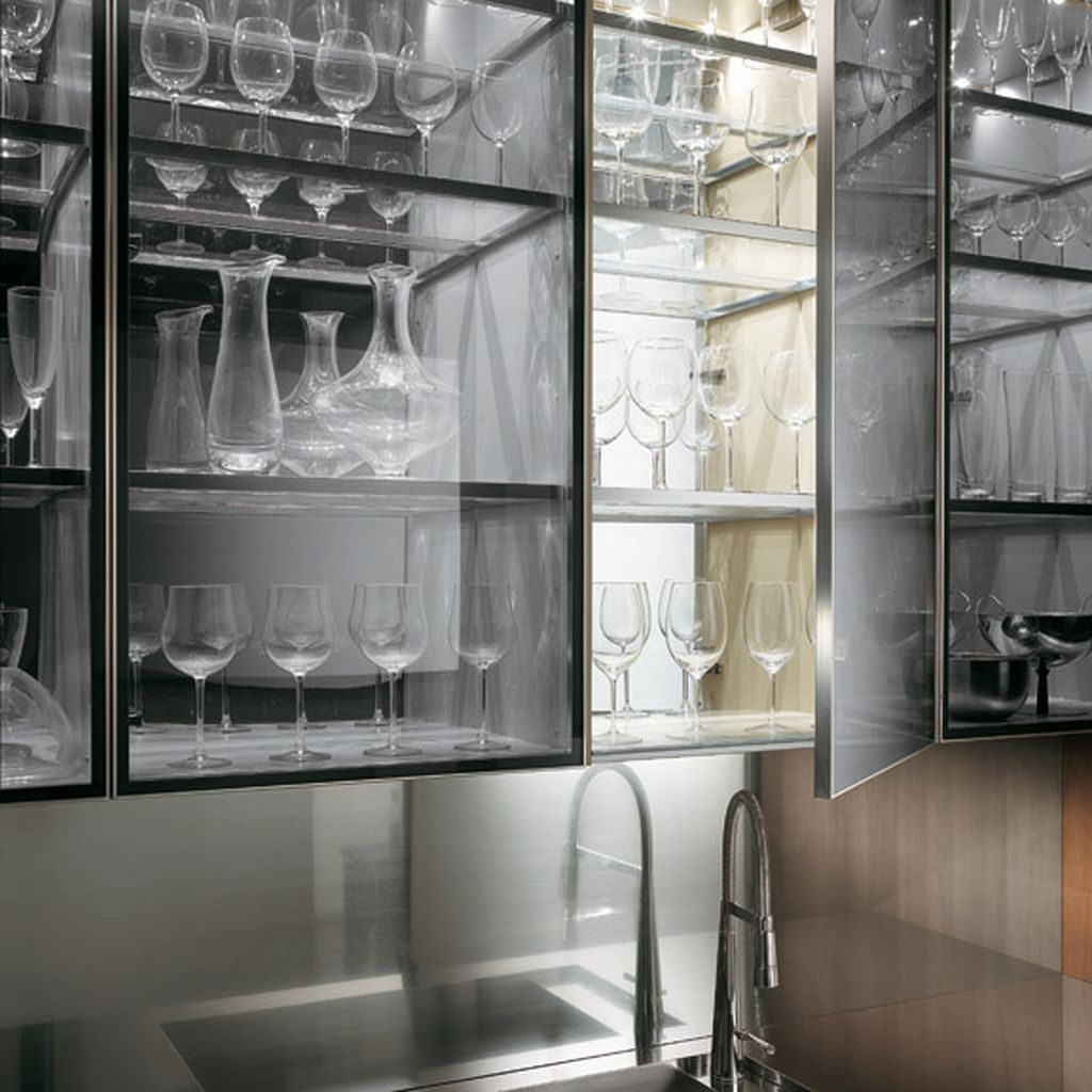 Modern Glass Cabinets For Kitchentransparent glass cabinet with a kitchen faucet in a natural