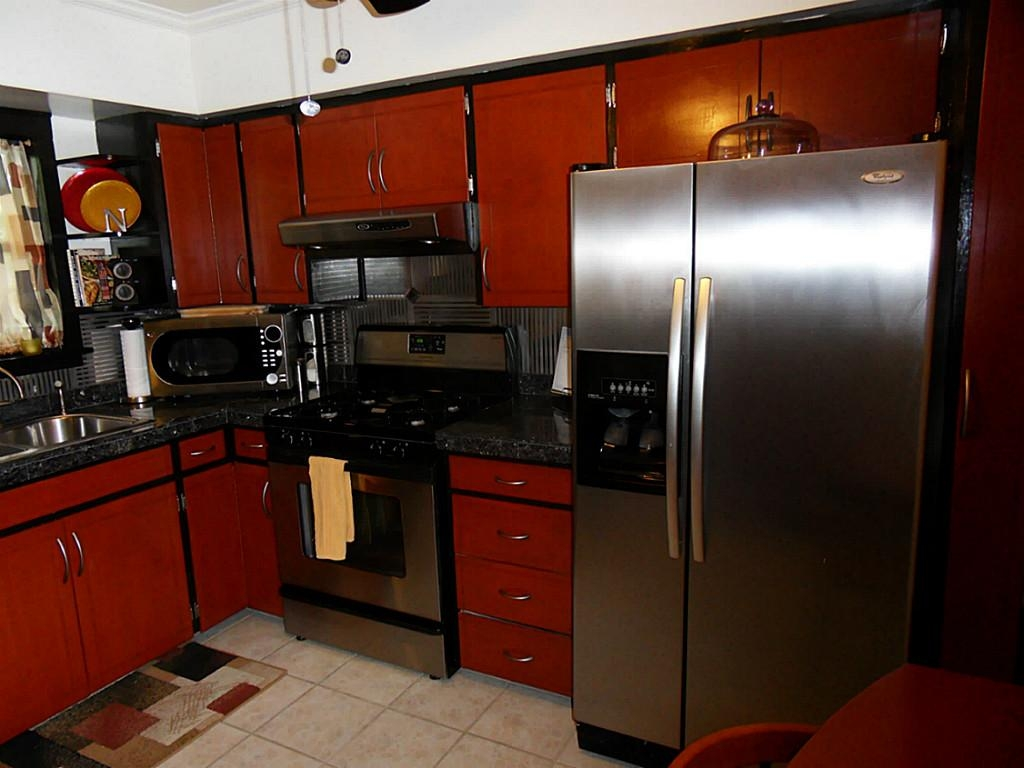 Red Kitchen Cabinets With Black Appliances