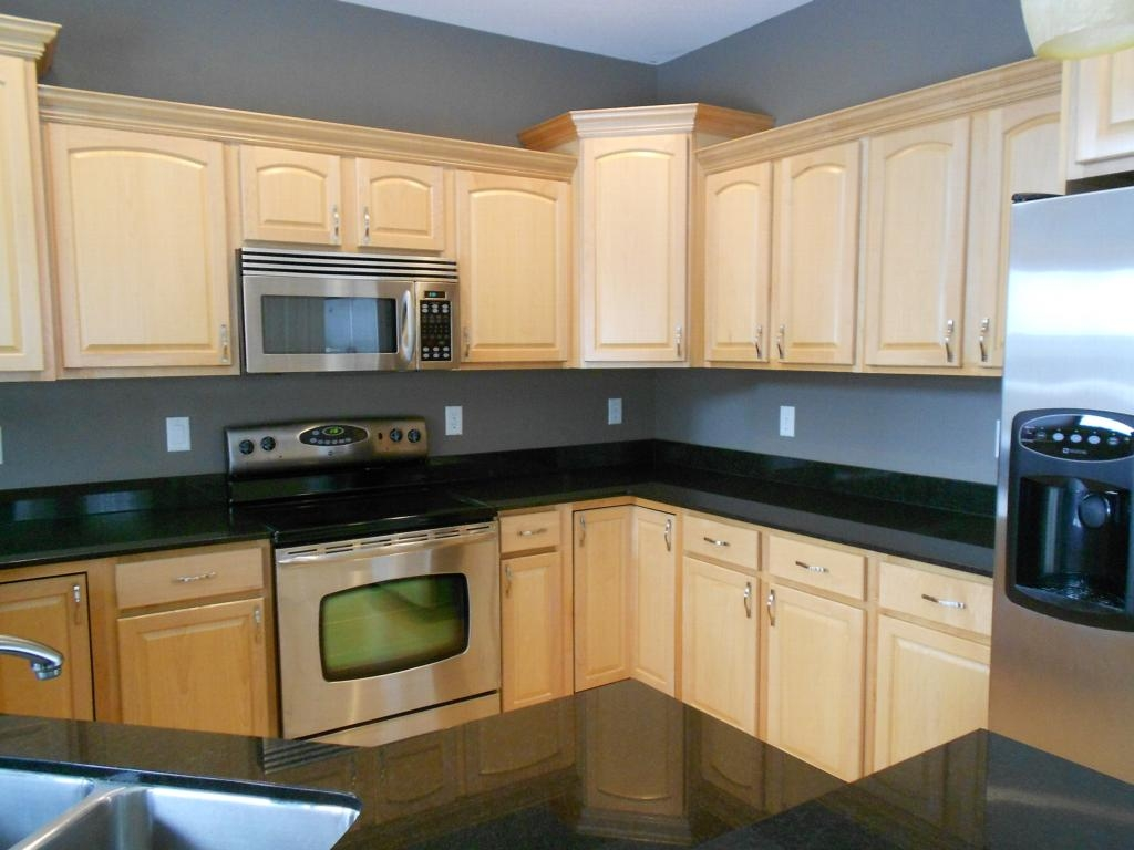 Kitchens With Maple Cabinets And Black Countertops