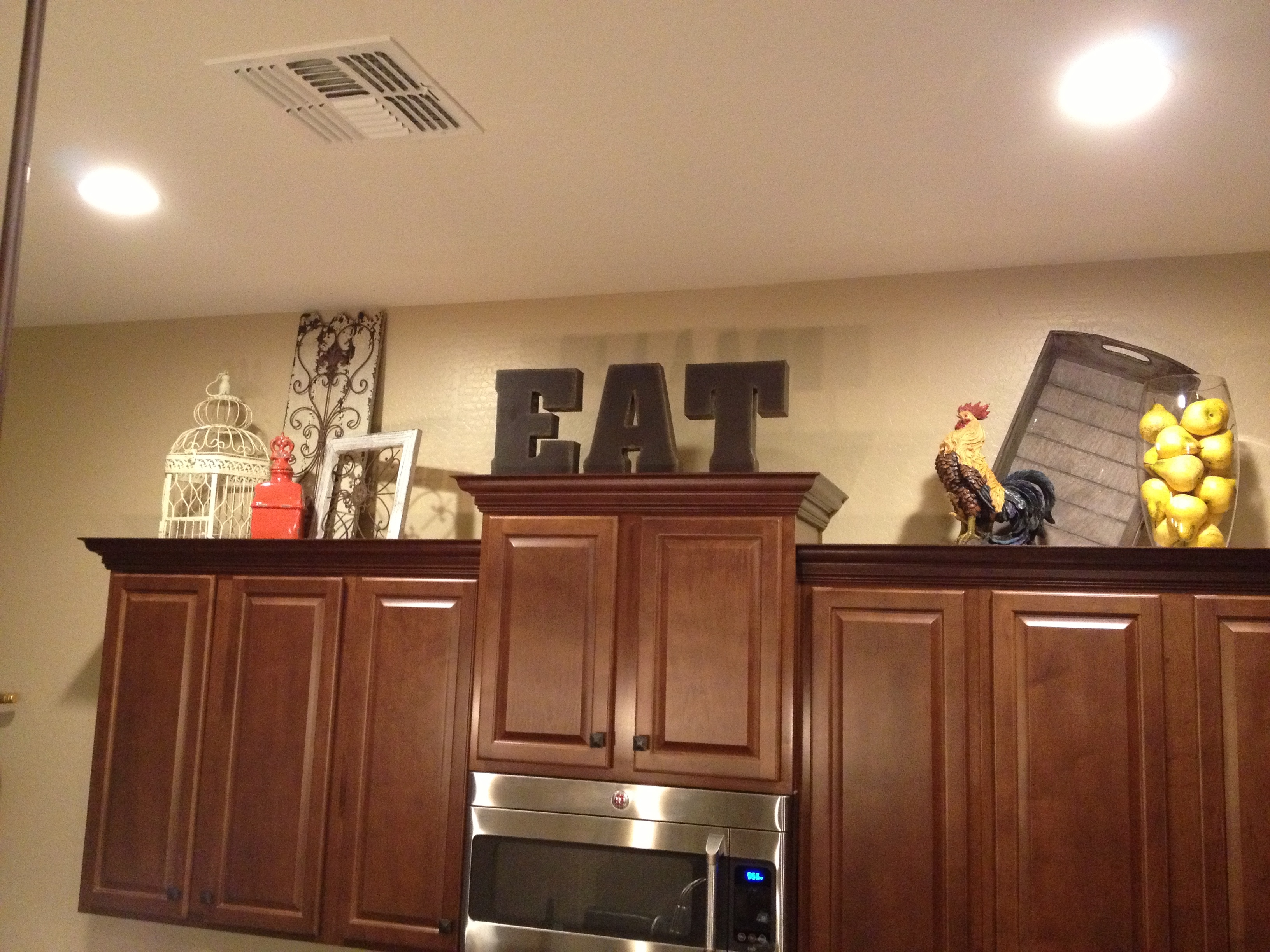 Simple Decor Above Kitchen Cabinets