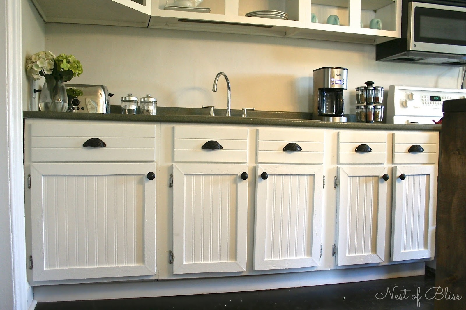 White Beaded Kitchen Cabinets