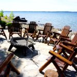 campfire chairs on lakefront