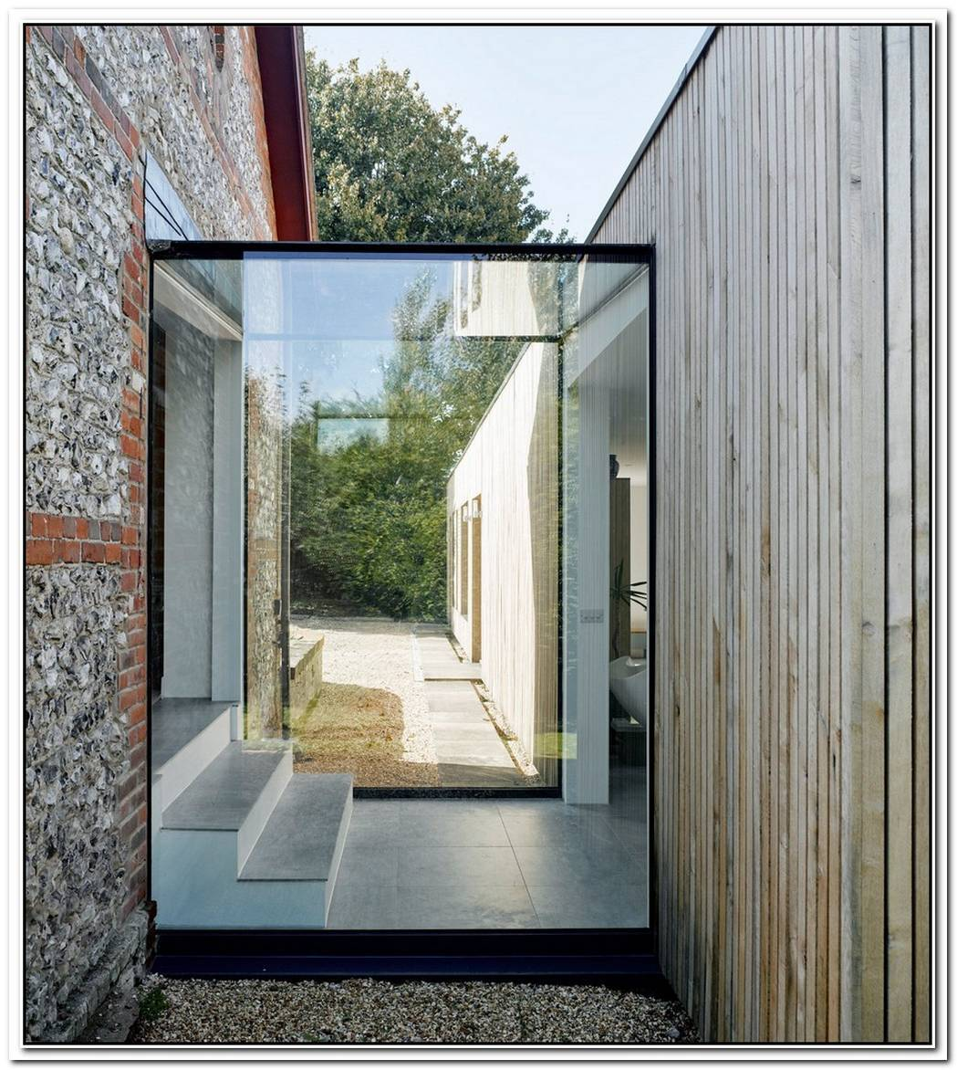 A Modern Glass Extension Built For An Adobe House