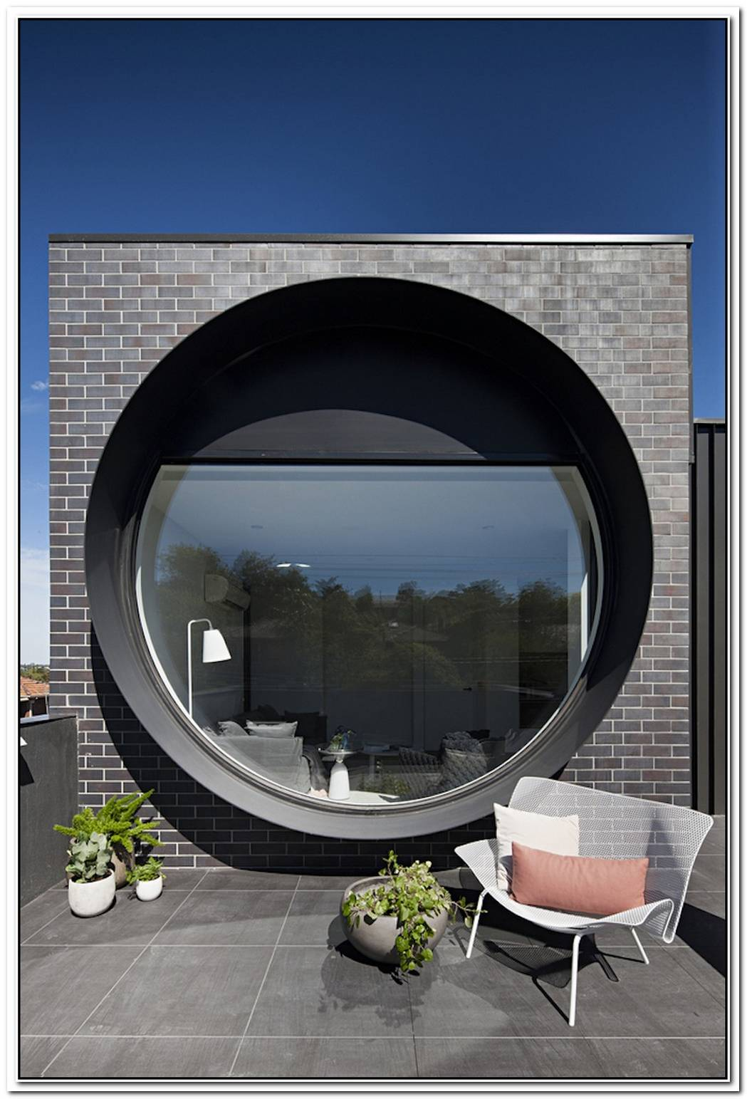 A Unique Apartment Building With Large Porthole Windows