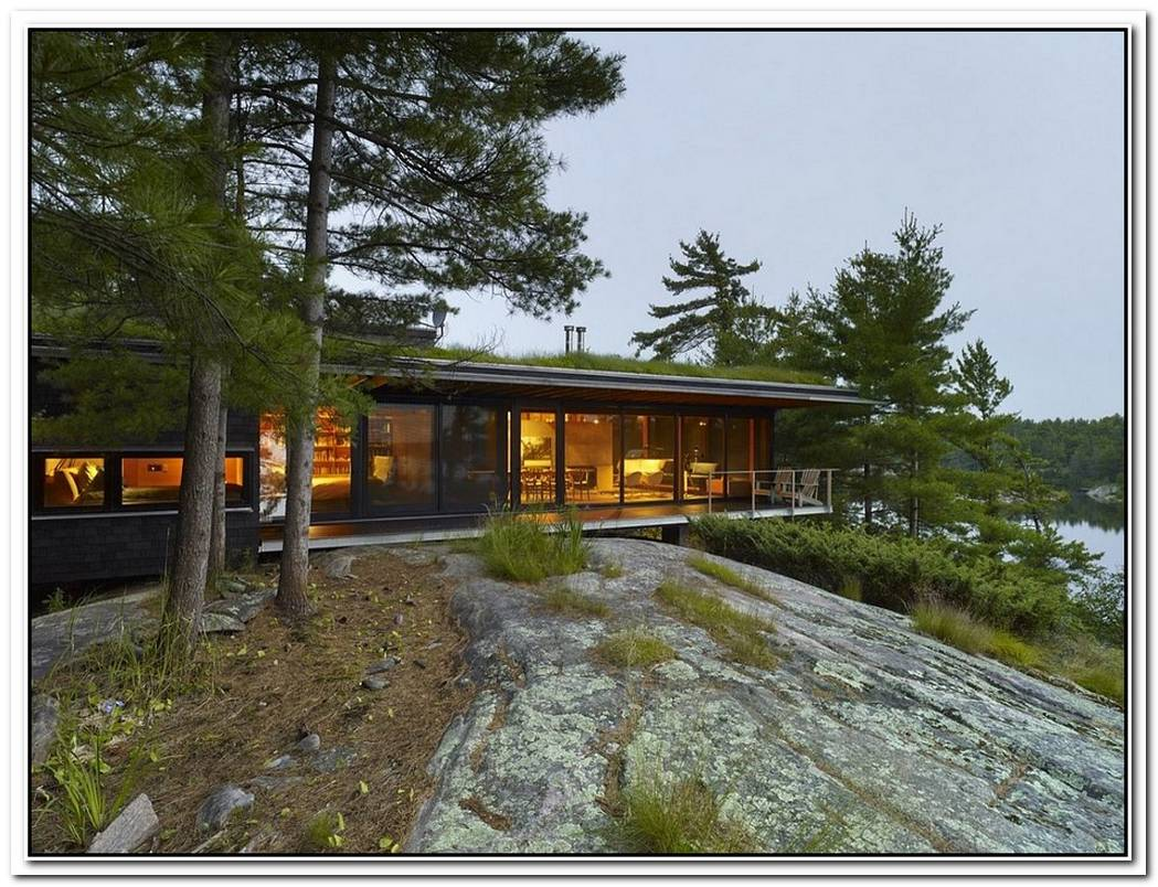 An Island RetreatCabin With Green Roof Offers A CozyMagical Escape