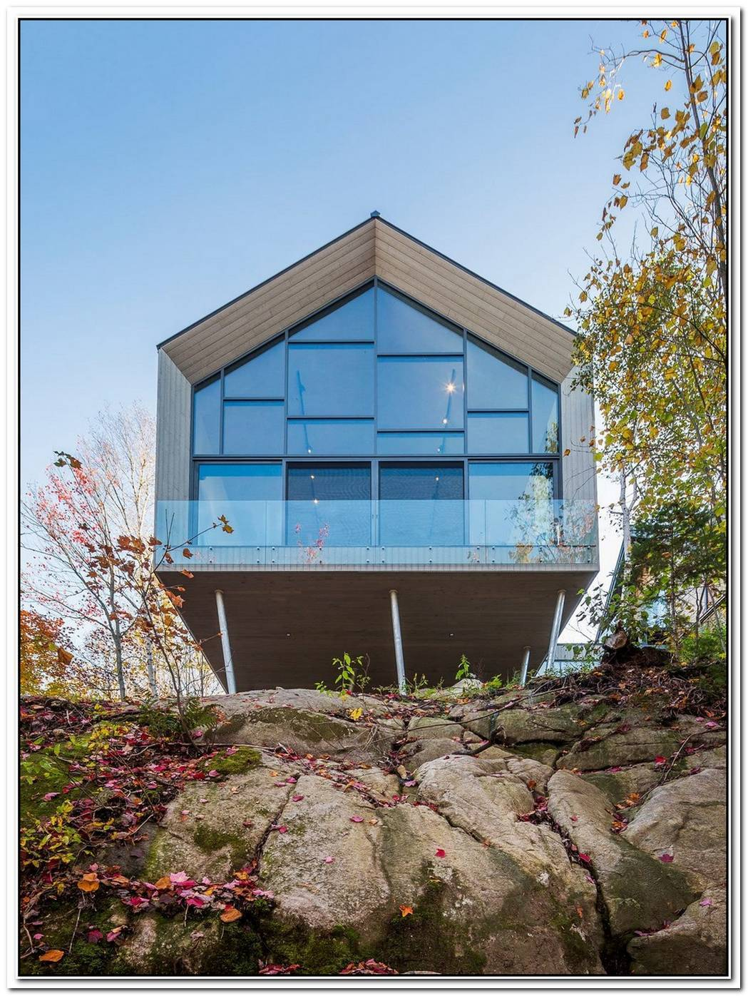 Cantilevered Home Overlooks The Lake In Quebec