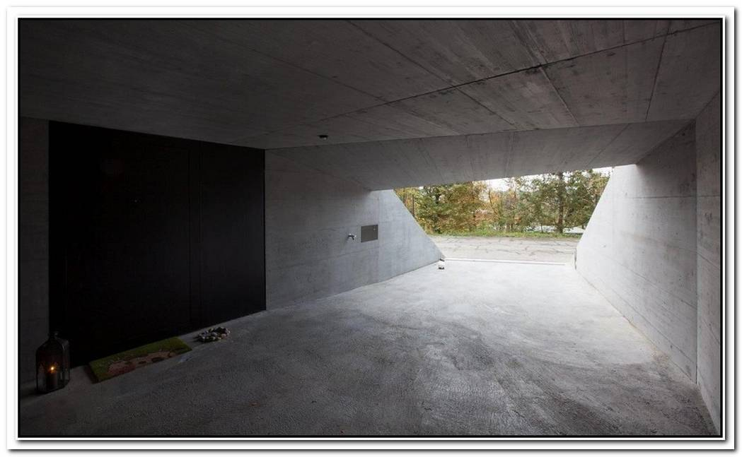 Elevated Concrete House With An Outstanding Geometry