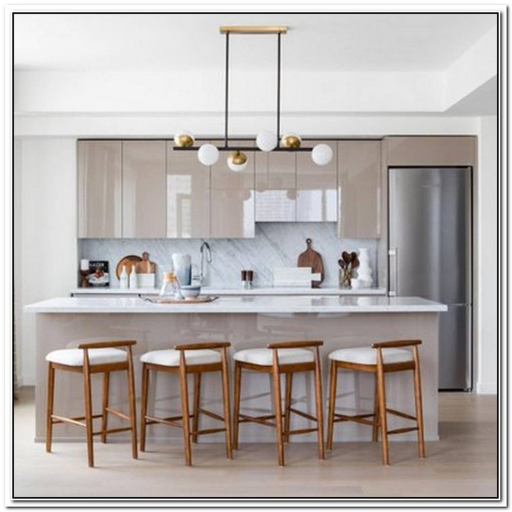 Glossy And Gilded Finishes Will Make A Minimalistic Kitchen Look Ultra Luxe