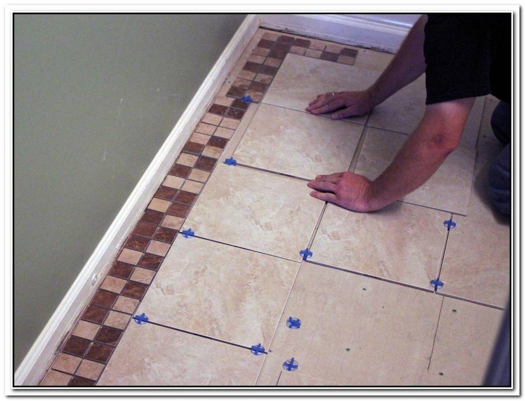 How To Tile A Bathroom Floor Yourself [The Easy Way]