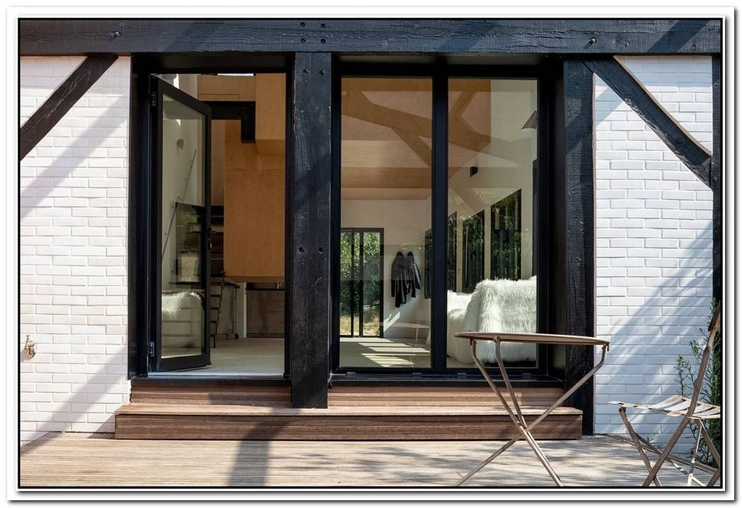 Old Carpenter'S Studio Altered Into A Chic Home With Suspended Wooden Cabanas