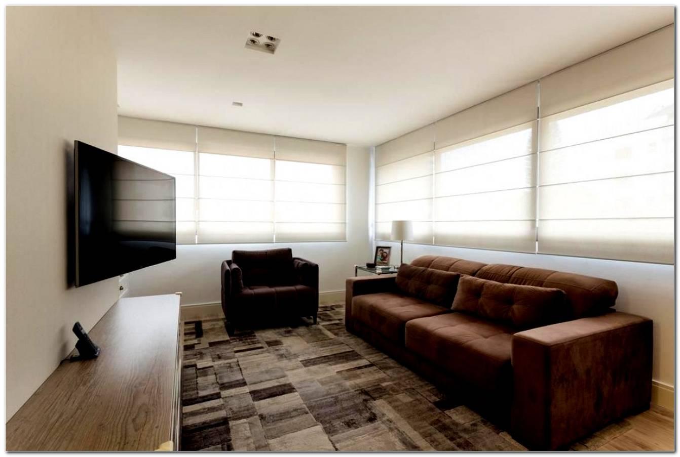 Sala Pequena Decorada Com Sofa E Poltrona 1