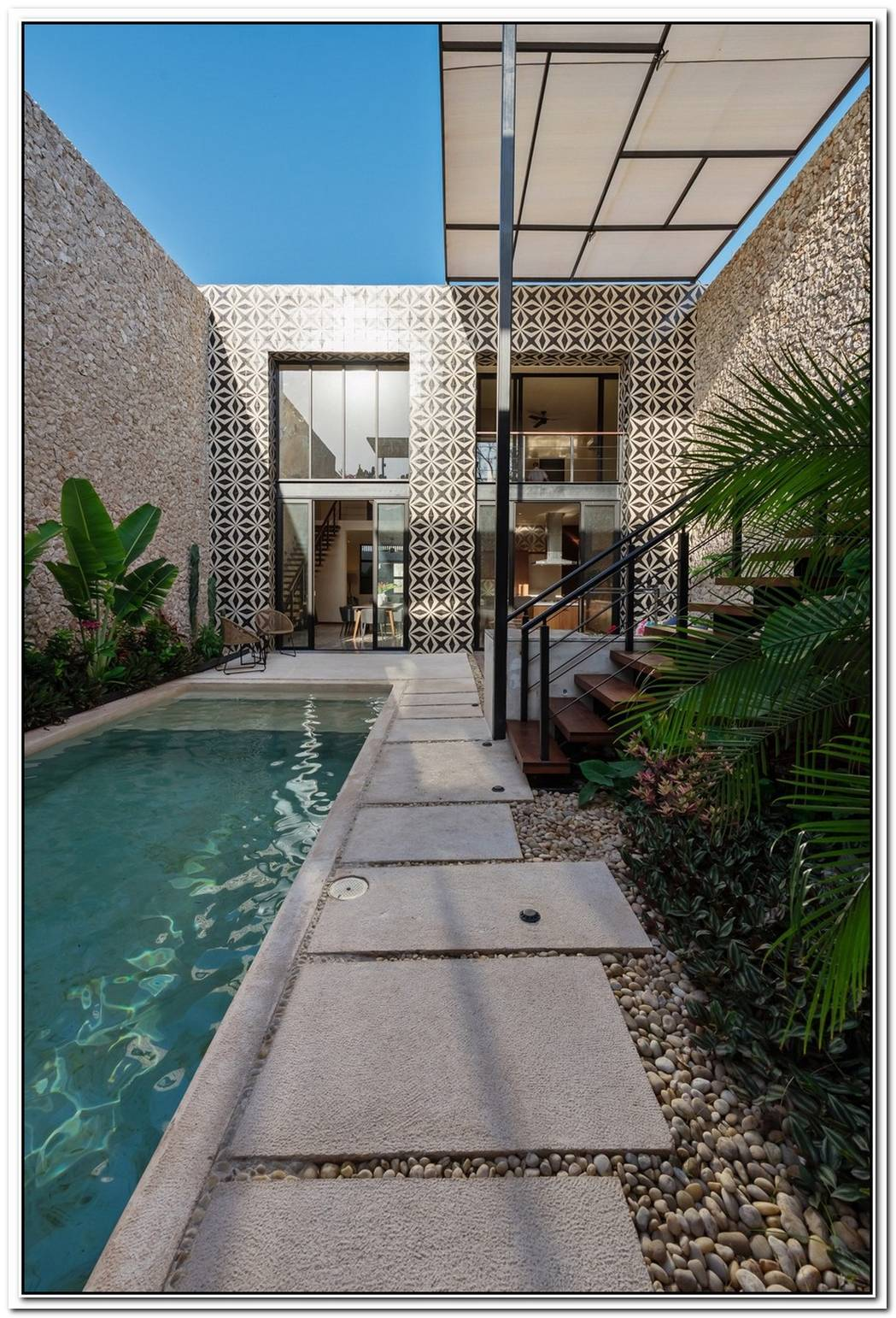 Unique Stone And Mosaic Work Wows In This Modern Home Design