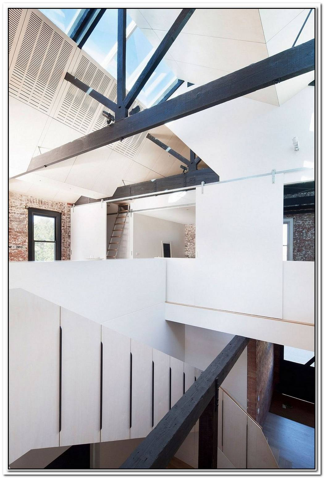 Water FactoryExtended Family House Takes Shape Inside Industrial Warehouse