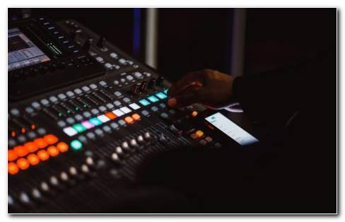 A Man In Studio Operating Mixing Consolew