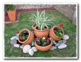 Flower Pots And Rocks Make A Cute Addition To Your Outside Landscaping.