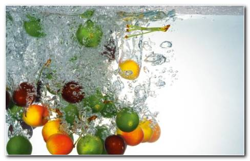 Fruits Falling In The Water HD Wallpaper