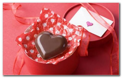 Full Of Chocolate Heart With A Red Packing And Love Letter