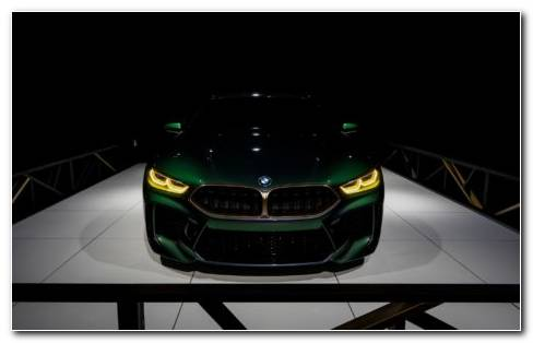 Green BMW Standing In A Garage Under Shadow