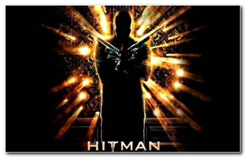 Hitman Standing With Guns HD Wallpaper