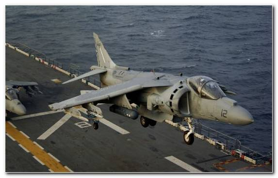 Image Amphibious Assault Ship Harrier Jump Jet Airplane McDonnell Douglas AV 8B Harrier II Military Aircraft