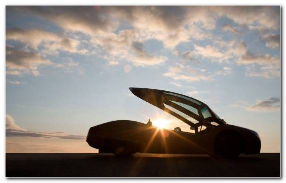 Image Sunrise Car Automotive Exterior Passenger Sunlight