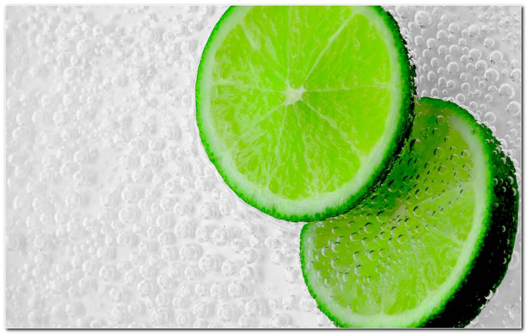 Lemon Slice Green Piece Wet Bubbles. Green Background Wallpaper