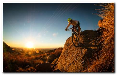 Man Cycling On Mountain HD Wallpaper