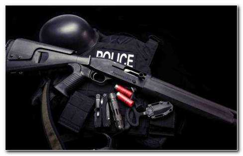 Mossberg Shotgun With Bullets Helmet And Police Vest