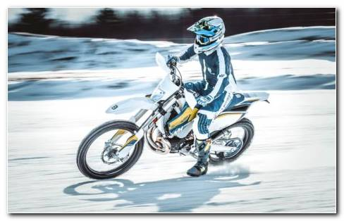 Motorcyclist In Fast Speed On Snow Tracks