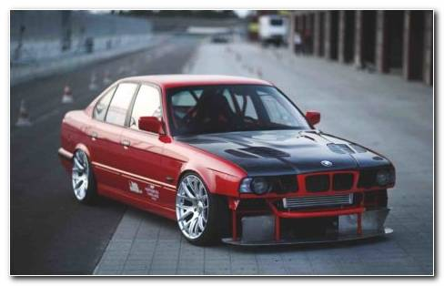 Red And Black BMW 535i E34 Car On Road