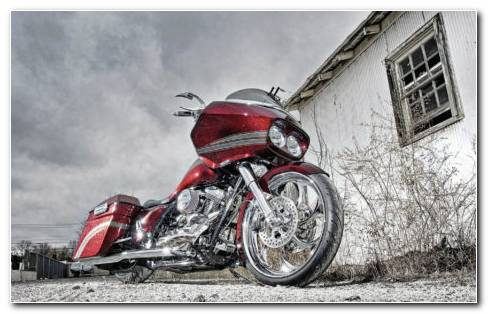 Red bike on streets HD wallpaper