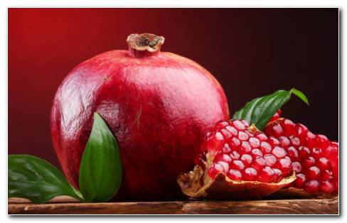 Red & Juicy Pomegranate HD Wallpaper
