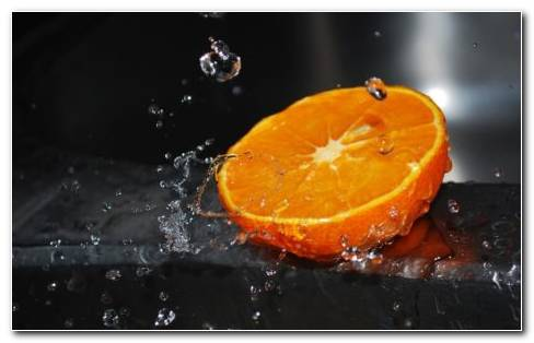 Splashed Orange HD Wallpaper