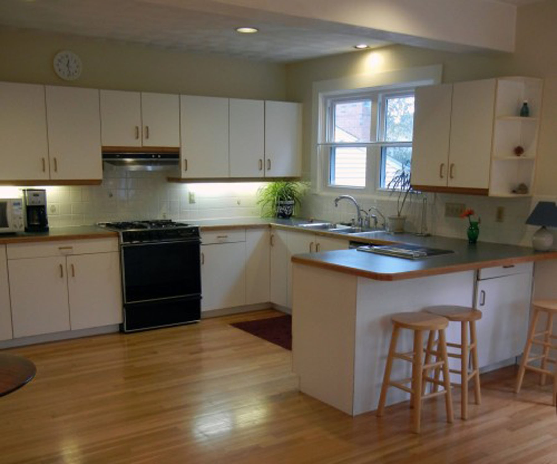 White Laminate Kitchen Cabinets With Wood Trim