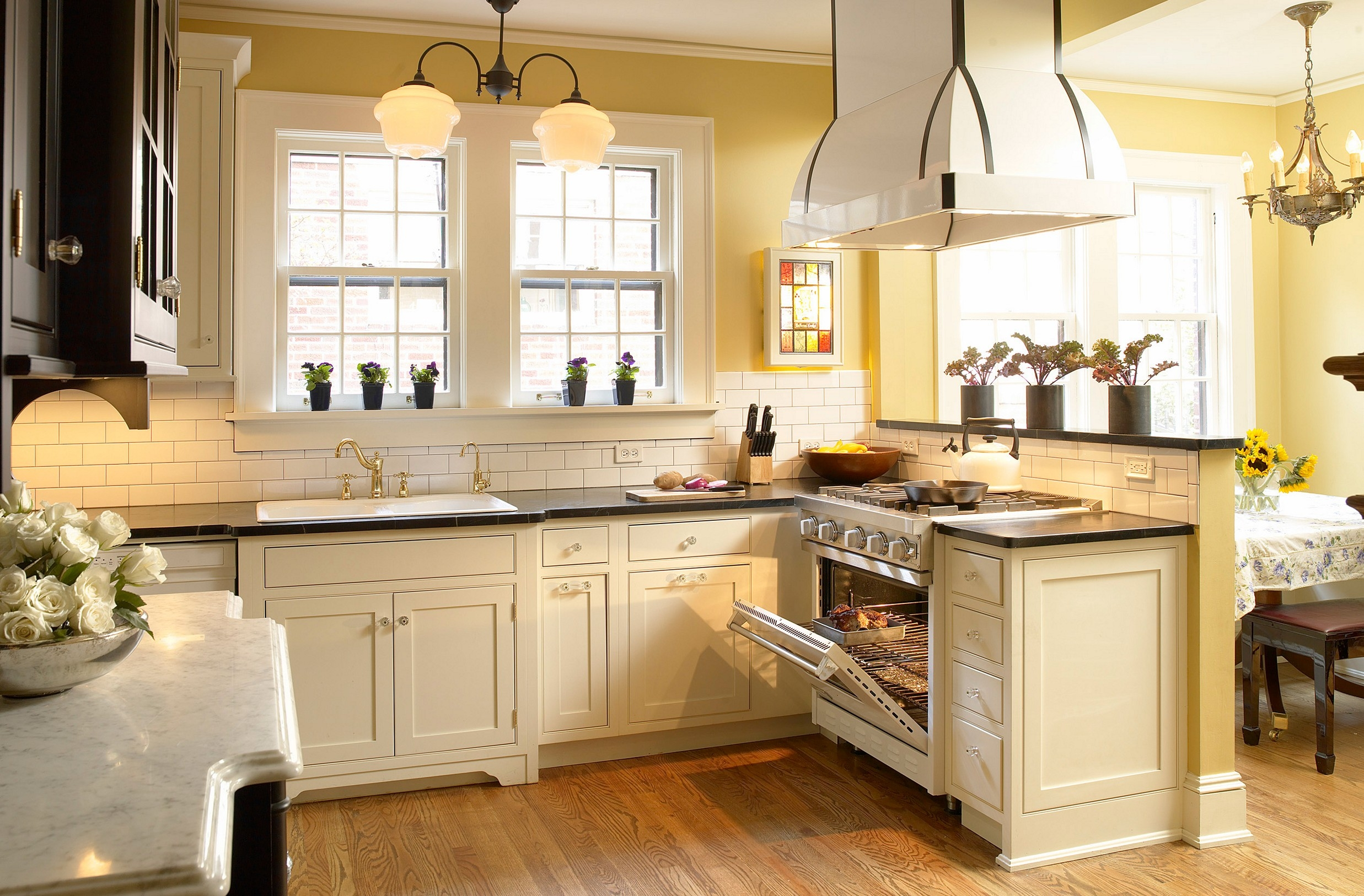 Cream Colored Kitchen Cabinets With Dark Countertops