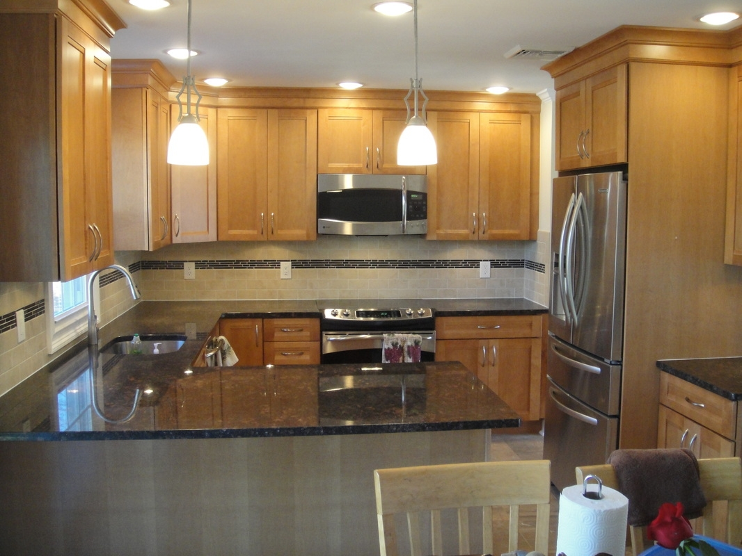 Kitchen With Maple Cabinets And Stainless Steel Appliances