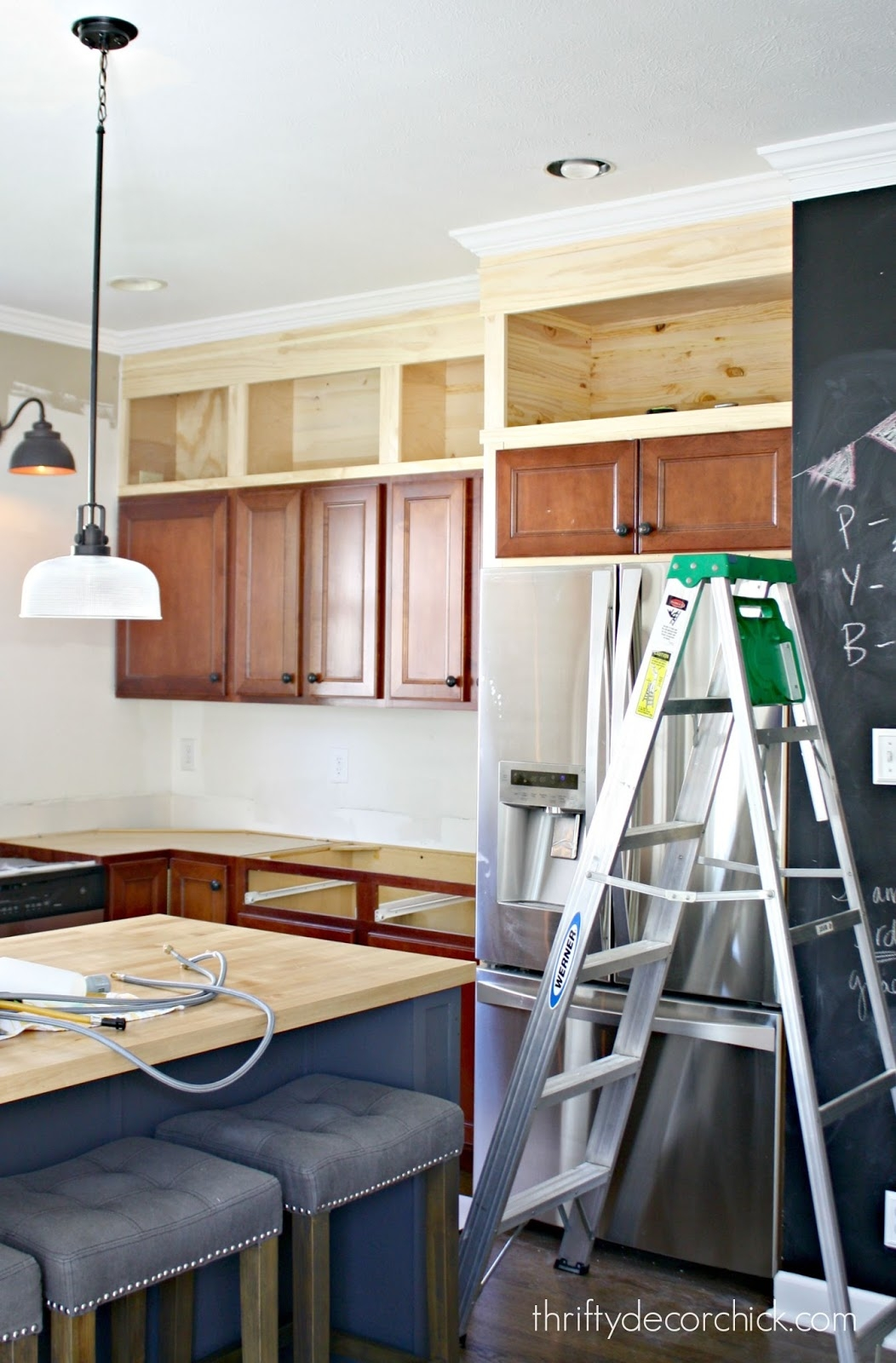 Picture Frames Above Kitchen Cabinets