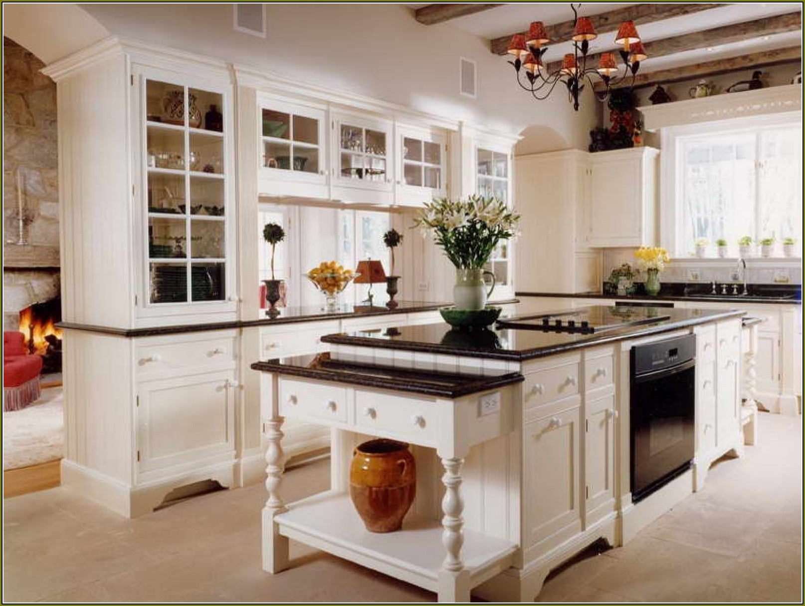 Antique White Kitchen Cabinets And Black Counters