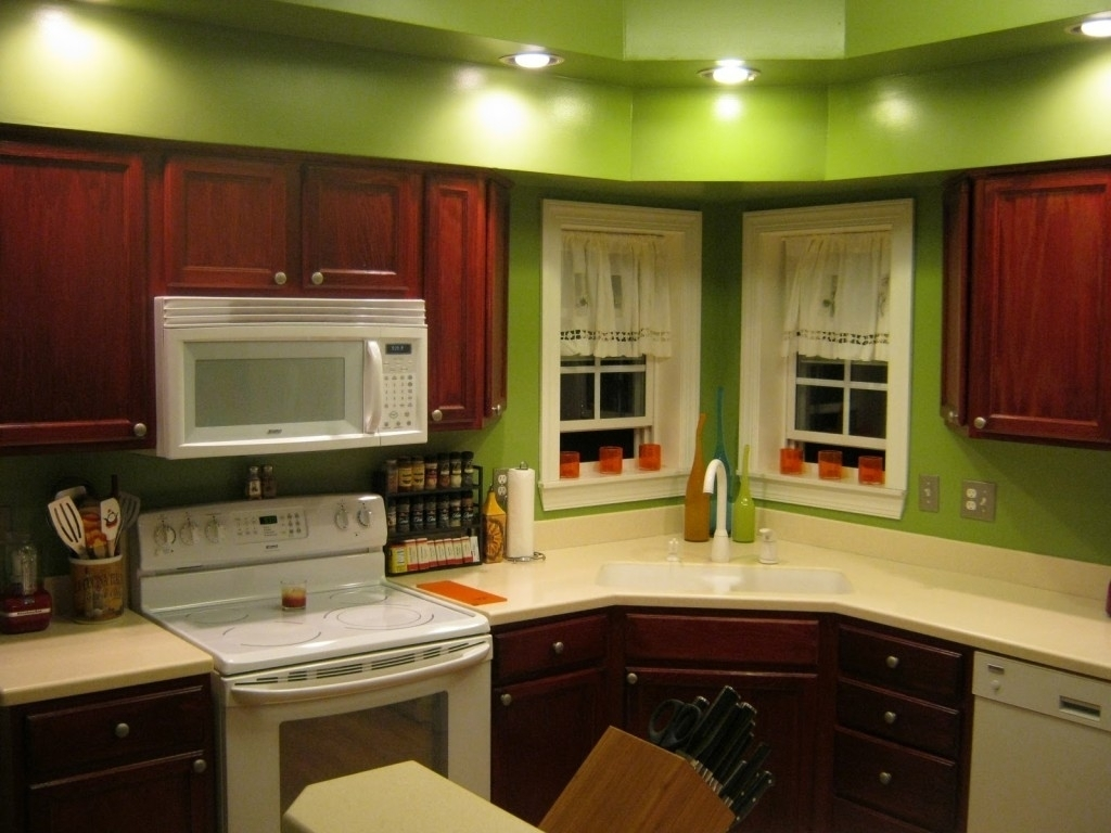 Brown Kitchen Cabinets With Green Walls