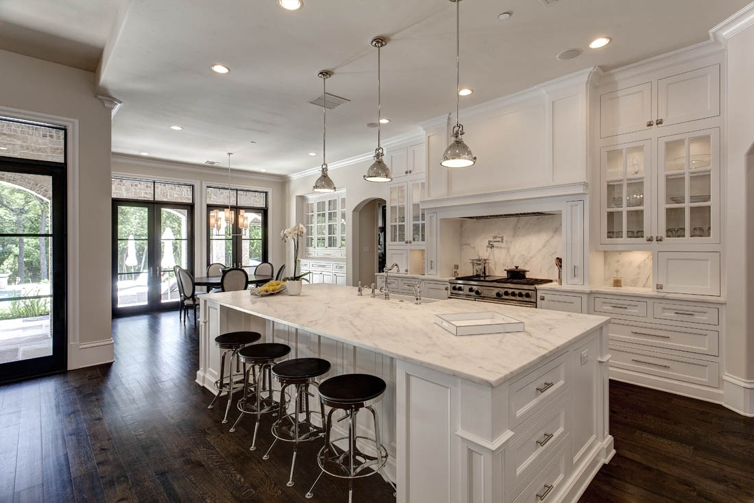 Open Concept Kitchen With White Cabinets